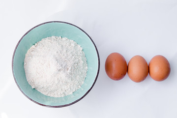 Preparation for baking. Eggs with flour