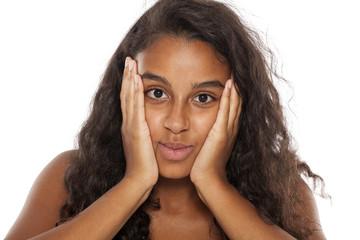 amazed dark skinned beautiful girl on white background