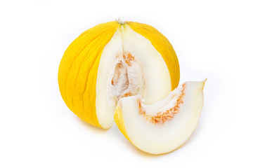 Ripe yellow casaba melon with a slice on white background.