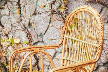 autumn mood. Wicker chair stands in autumn park