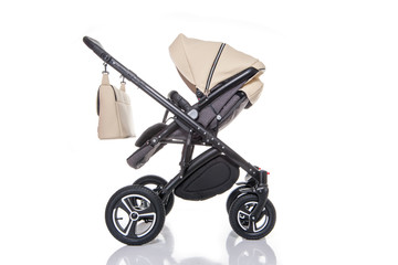 Baby carriage on white background in studio