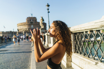Woman taking photo of sightseeing