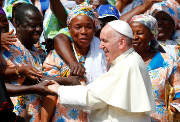 Pope Francis is greeted by pilgrims from Africa during his Wednesday general audience in Saint Peter's square at the Vatican