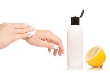 Female hand cosmetic with lemon wadded disk