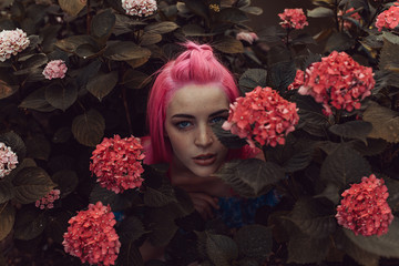 Woman posing in bright flowers