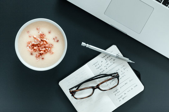 Coffee at laptop on desk