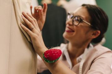 Female designer working on new dress design