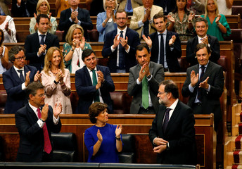 Spanish Prime Minister Mariano Rajoy is applauded during a parliamentary plenary session on the Gurtel corruption case in Madrid