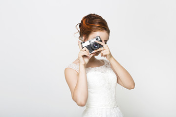 Young pretty bride with photo camera