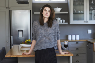 Gorgeous woman standing in kitchen, portrait