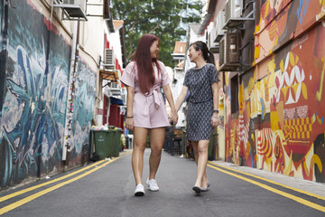 Beautiful girlfriends exploring Haji Lane, Singapore