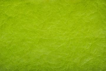Crumpled paper background. Green paper background. Texture of crumpled paper.
