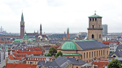 Church of Our Lady and cityscape, aerial view from the platform at the top of the Rundetaarn or Round Tower in old town, cloudy weather, Copenhagen, Denmark