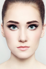 Close-up portrait of young beautiful woman with fresh make-up