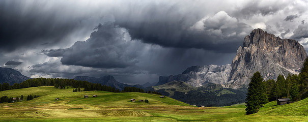 Fotobehang Onweer Storm over the mountains Dolomiti in the summer season with meadow in foreground