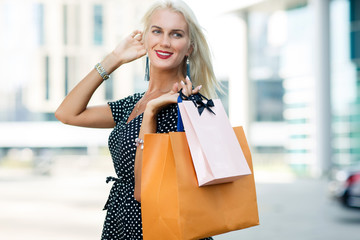 Image of blonde with purchases