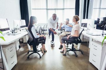 businessman on skateboard in office