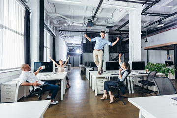 businessman dancing on table