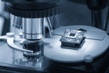 The abstract scene of microscope and the microchip.Hi-precision micro processor  manufacturing concept.