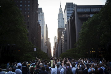 """People clamor to take photos of the effect known as """"Manhattanhenge"""" but were thwarted by clouds from seeing the sunset in the Manhattan borough New York"""