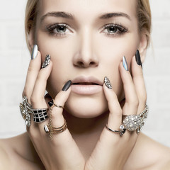 beauty face.woman's hands with jewelry