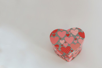 Close-up of heart-shaped jewelry box on white background. Concept holiday.
