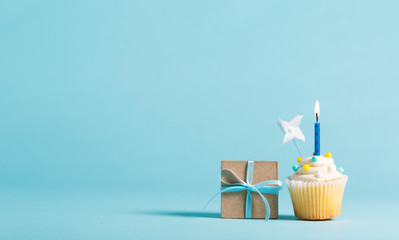 Cupcake with candle and present box celebration theme