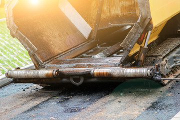 Carrying out repair works: asphalt roller stacking and pressing hot lay of asphalt. Machine repairing road