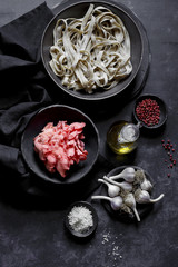 Ingredients for pasta, pink oyster mushrooms and garlic