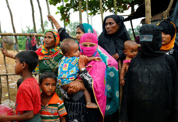 New Rohingya refugees wait to enter the Kutupalang makeshift refugee camp, in Cox's Bazar