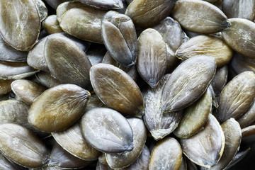 Close up picture of pumpkin seeds, shallow depth of field.