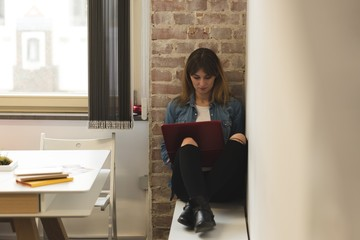 Woman using laptop in the cafe