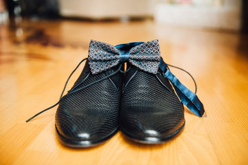 Male groom set of shoes and bow tie