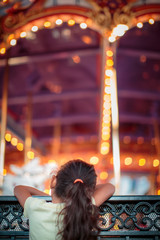 Young child looking at a carousel