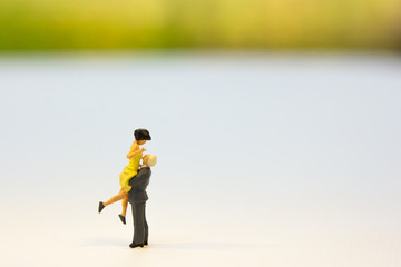 Miniature couple standing