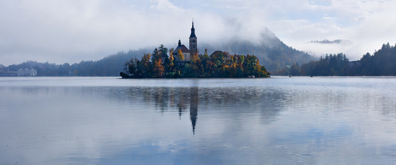 Lake Bled with St. Marys Church of the Assumption on the small island; Bled, Slovenia, Europe - panorama