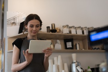 Female owner using digital tablet