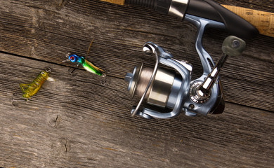 spinning rod  And bait on a wooden background