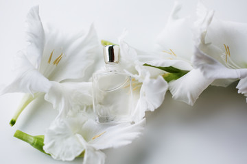 small perfume with white flowers