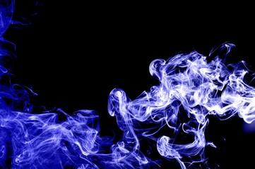 Abstract blue smoke on black background,blue ink background