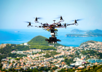 Professional movie camera drone flying over the marine city in the summer day.