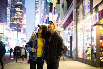 Young Asian couple exploring Times Square at night