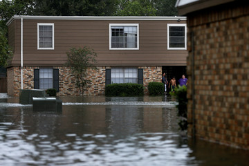 Residents wait to be rescued from their home flooded by Tropical Storm Harvey in Orange