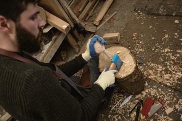 Carpenter making wooden spoon