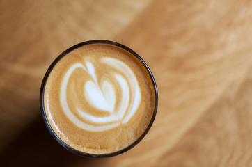 big cup of cappuccino coffee on cafe background