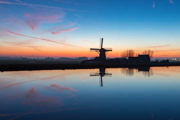 "Windmill ""the Adermolen"" at sundown in Abbenes."