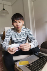Chinese man counting money at home