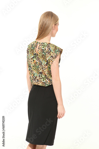 5de9efe843225d blond business woman in summer print sleeveless blouse and skirt back view high  heeled shoes full body portrait isolated on white
