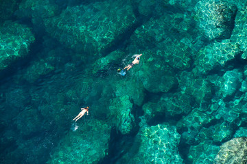 Above view of a couple snorkeling in the sea
