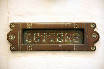 Vintage letterbox on white door